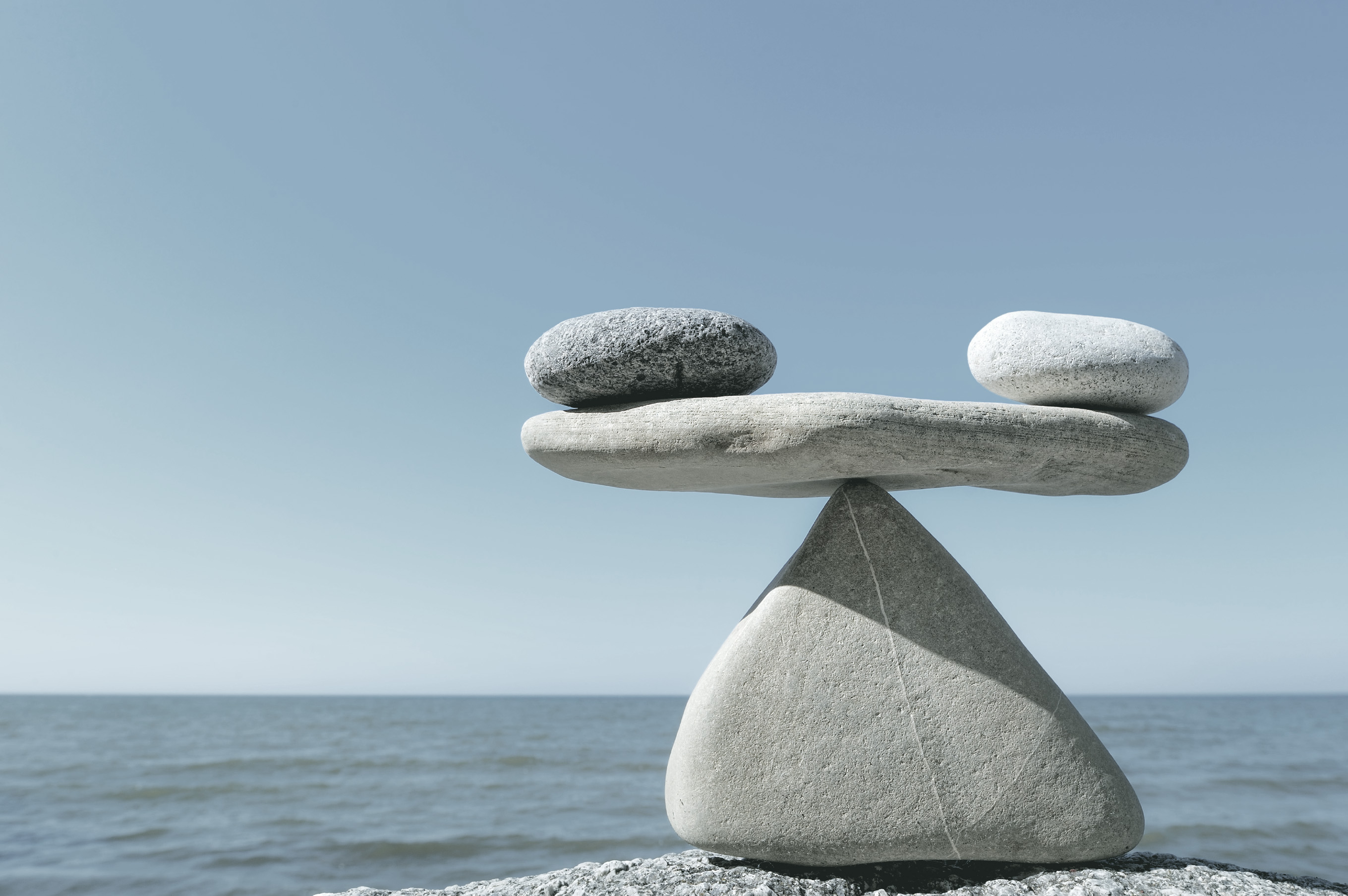 Symbol of the scales is made of pebble on the sea coast